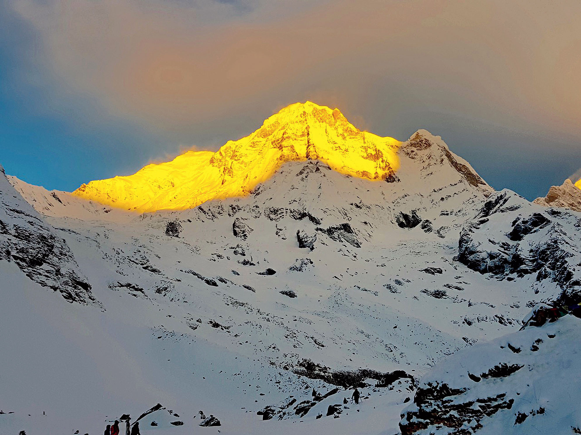 The Annapurna peak glows in the first light of the morning