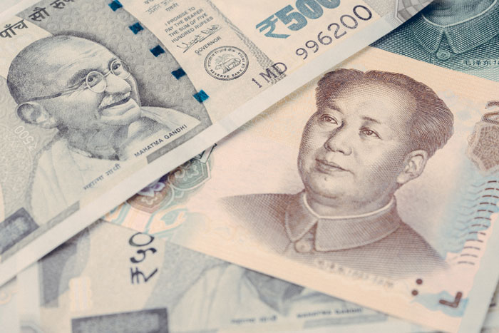 A stock image of Indian and Chinese currency