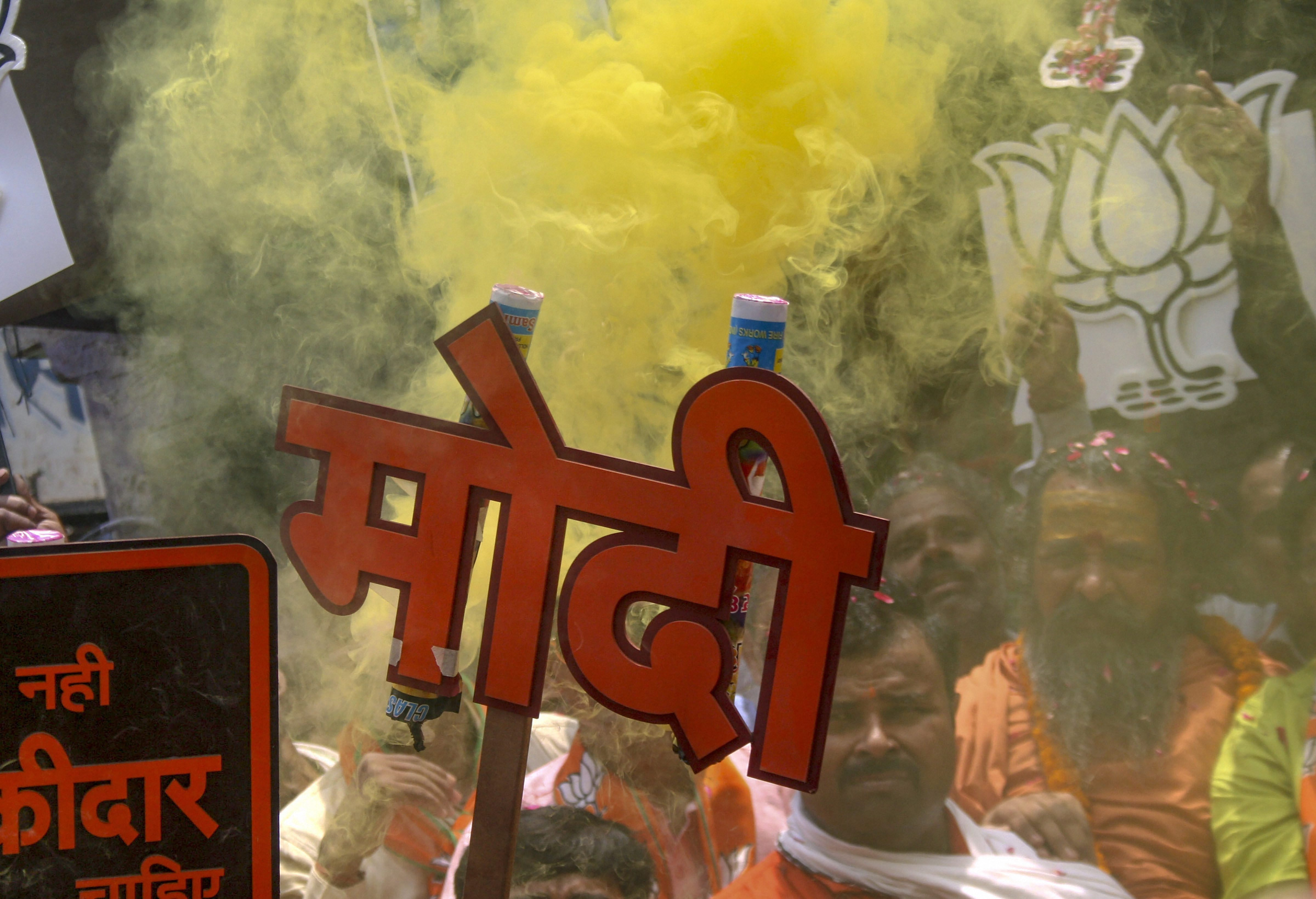 BJP workers celebrate the party's Lok Sabha election performance in Varanasi on May 23.
