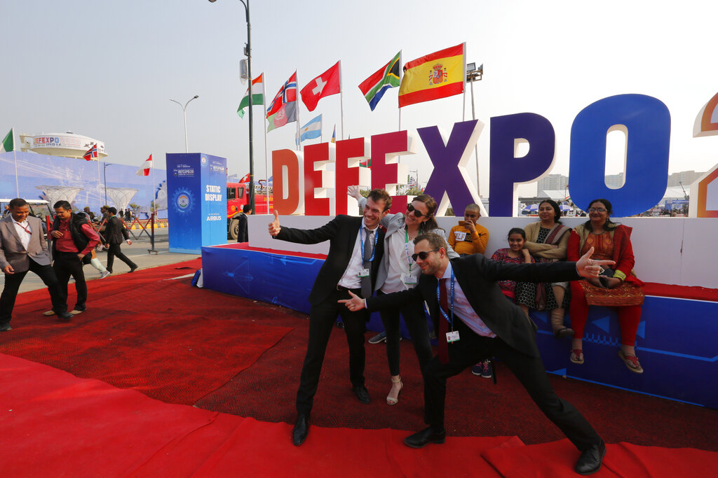 Delegates from France take a photograph at the DefExpo in Lucknow, India, on Thursday