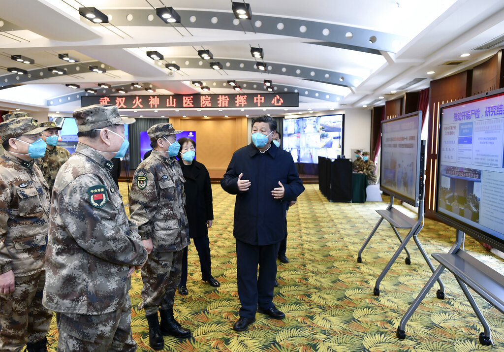 Chinese President Xi Jinping (right) is briefed about the Huoshenshan Hospital in Wuhan on Tuesday