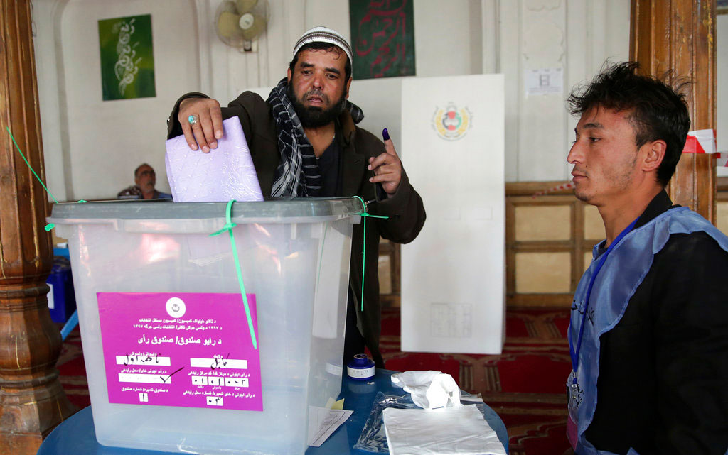 A man casts his vote in Parliamentary elections in old city of Kabul, Afghanistan, on Saturday. Tens of thousands of Afghan forces fanned out across the country as voting began Saturday in the elections that followed a campaign marred by relentless violence.