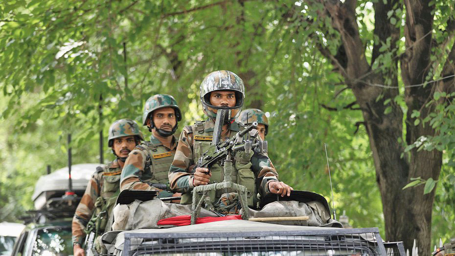 Soldiers on a vigil near a war memorial in Srinagar on July 26, 2019. The deployment of supplementary security men is seldom a sign of normalcy. On the contrary, it speaks of a situation where the bullet threatens the ballot, that too in a democracy.