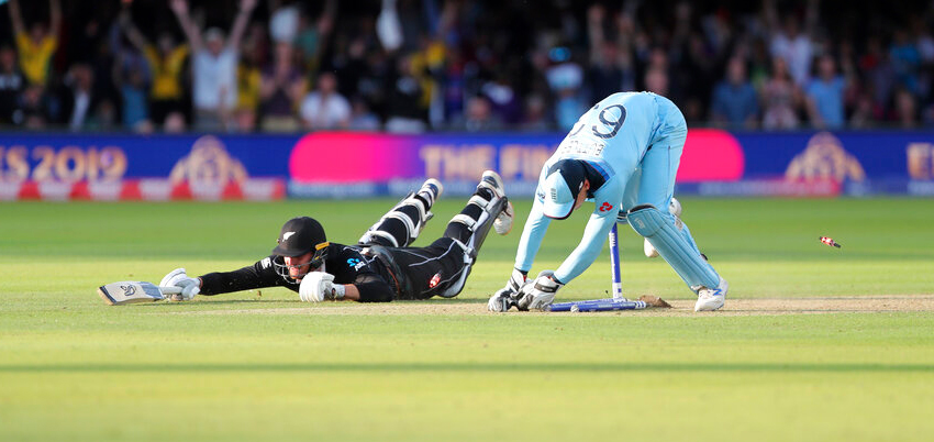 England's Jos Buttler runs out New Zealand's Martin Guptill during the Super Over in the Cricket World Cup final match between England and New Zealand at Lord's cricket ground in London, England, Sunday, July 14, 2019.