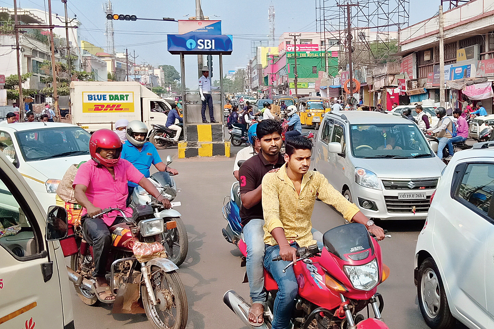Motorists negotiate busy traffic at Ravi Talkies Square in Bhubaneswar.