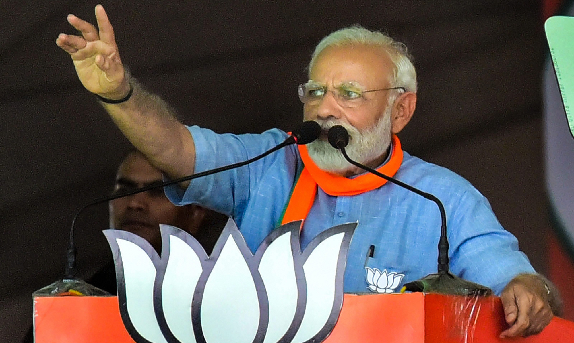 Prime Minister Narendra Modi gestures as he speaks at an election campaign rally during the ongoing general elections, in Aligarh, on Sunday, April 14, 2019.