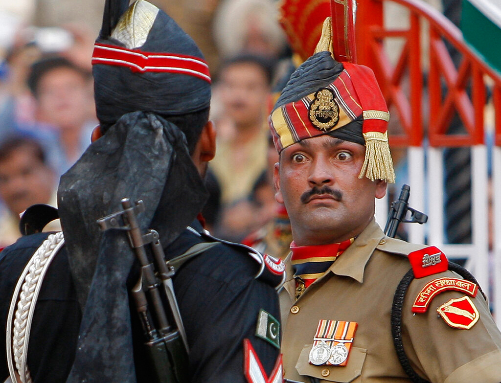 In this July 19, 2009, file photo, an Indian Border Security Force soldier, right, and a Pakistani Rangers soldier face one another at a daily closing ceremony at the Wagah border post near Lahore, Pakistan.