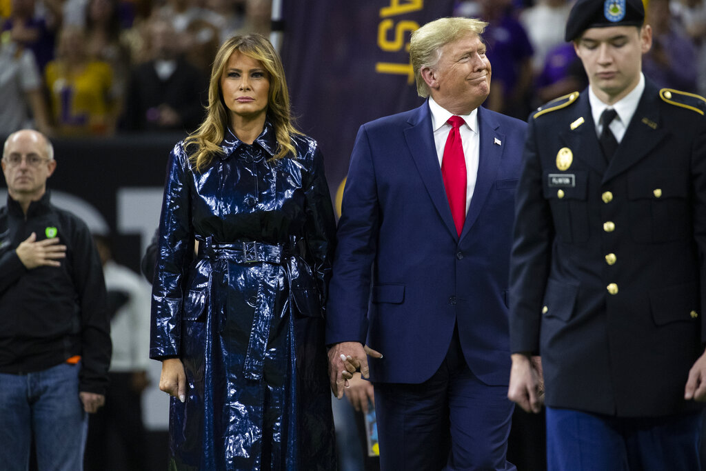 US President Donald Trump and first lady Melania Trump arrive for the College Football Playoff National Championship game between LSU and Clemson, Monday, January 13, 2020, in New Orleans