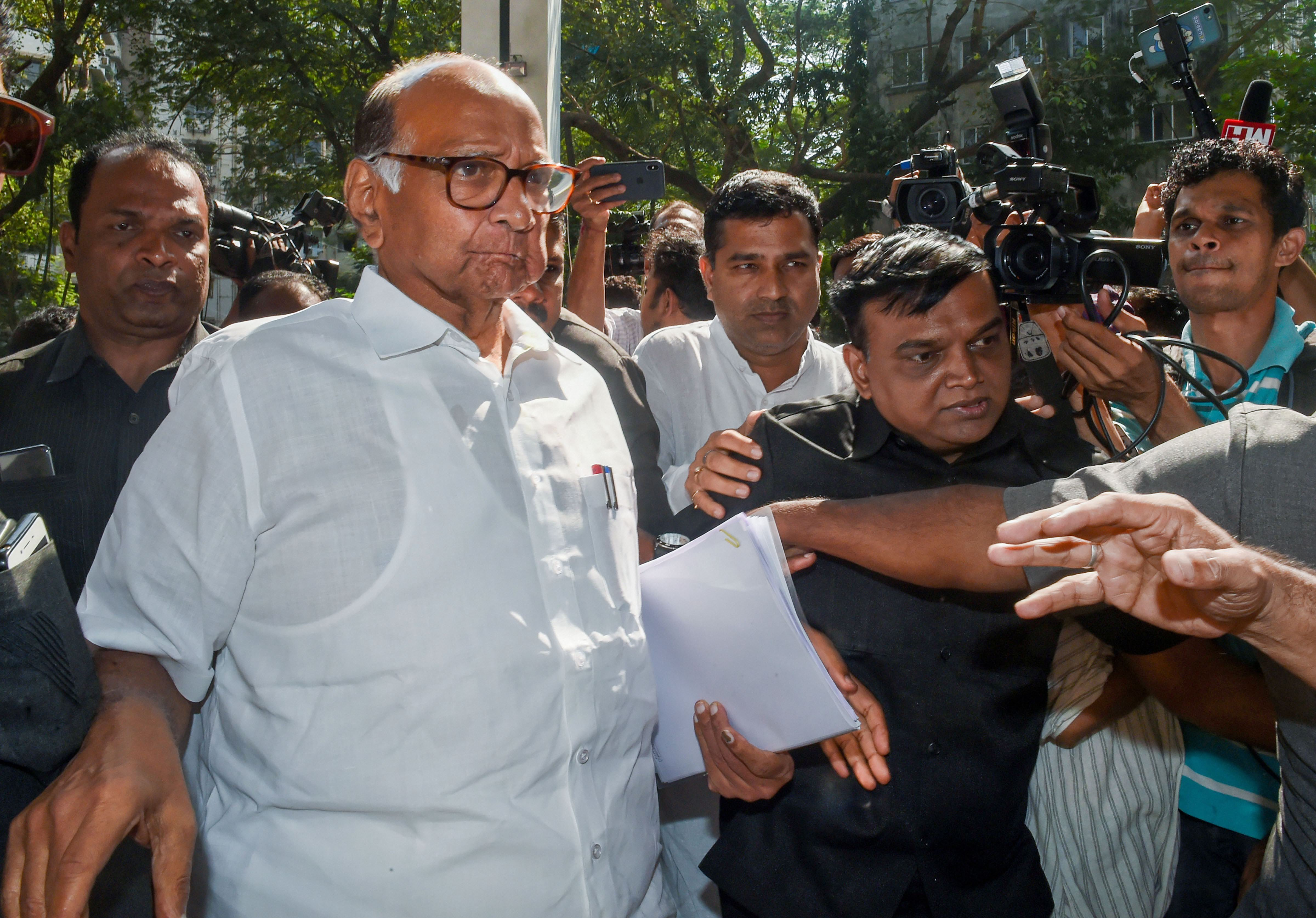 NCP president Sharad Pawar arrives for a press conference, in Mumbai, Saturday, November 23, 2019.