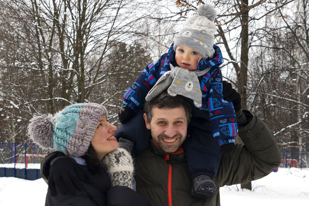 Ilya Zhegulev, a journalist for the Latvia-based Russian website Meduza, his son Ivan and his wife Katya in Moscow.