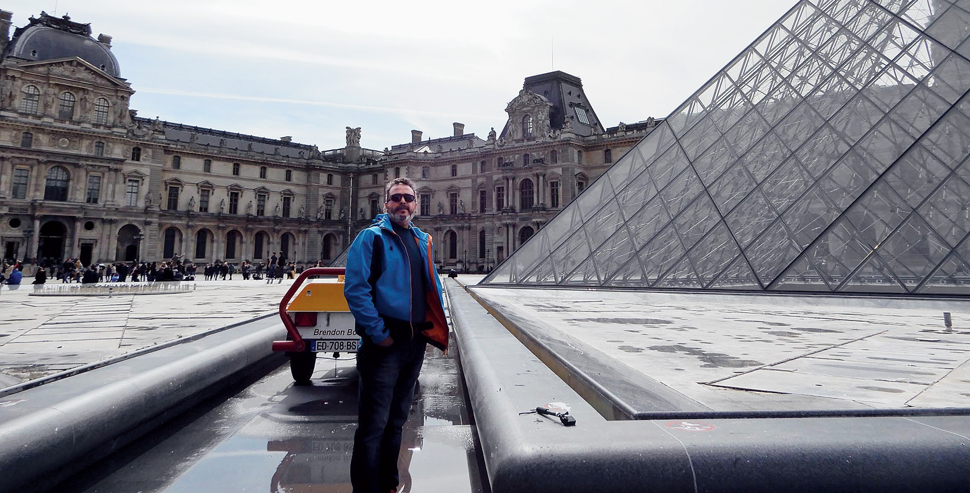 Joydeep Karmakar in front of the Louvre on April 5, the same day he visited Notre-Dame cathedral. Karmakar had represented India at the 2012 London Olympics in the men's 50m rifle prone event.