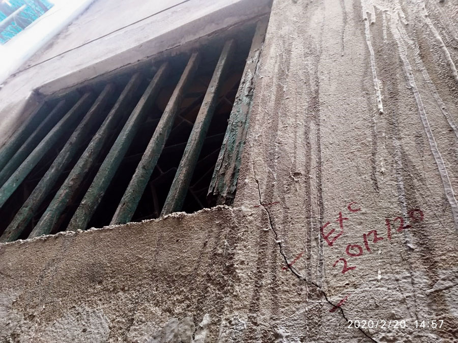 A crack in a building in Chaitan Sen Lane marked