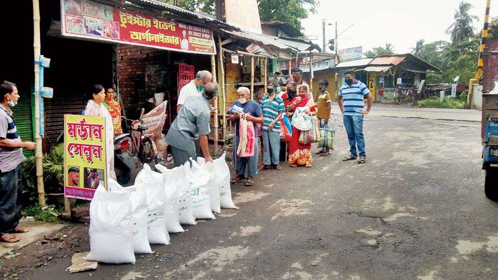 Distribution of dry ration at Ashoknagar, in North 24-Parganas, on Saturday