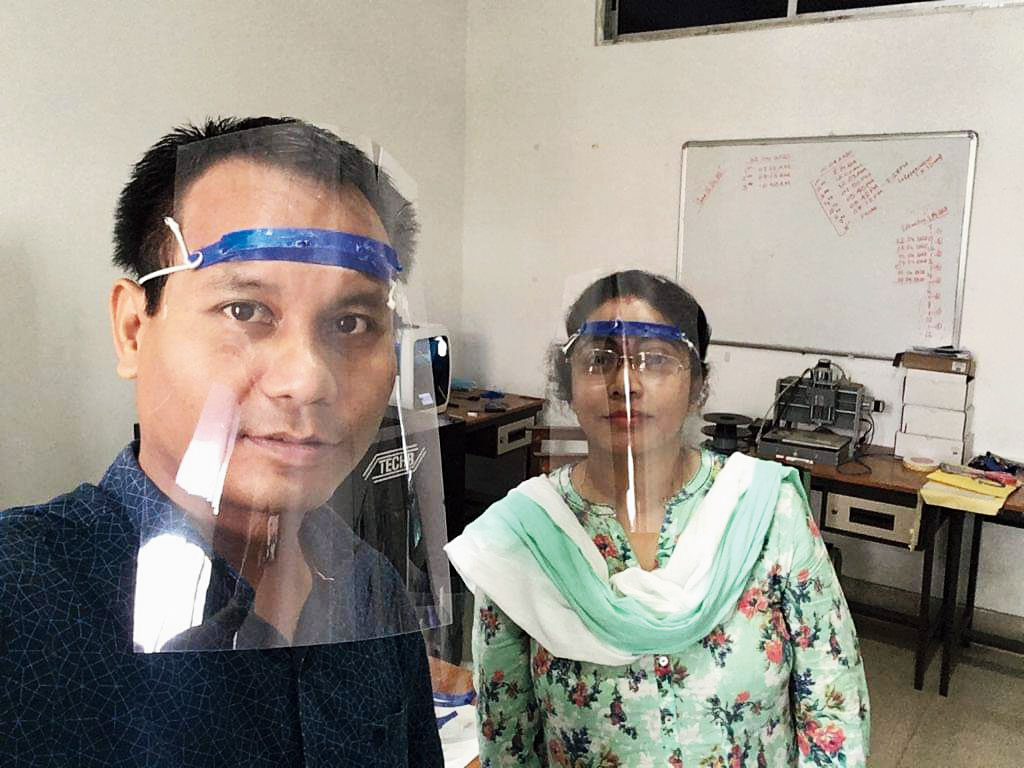 Tezpur university faculty members display the face shield