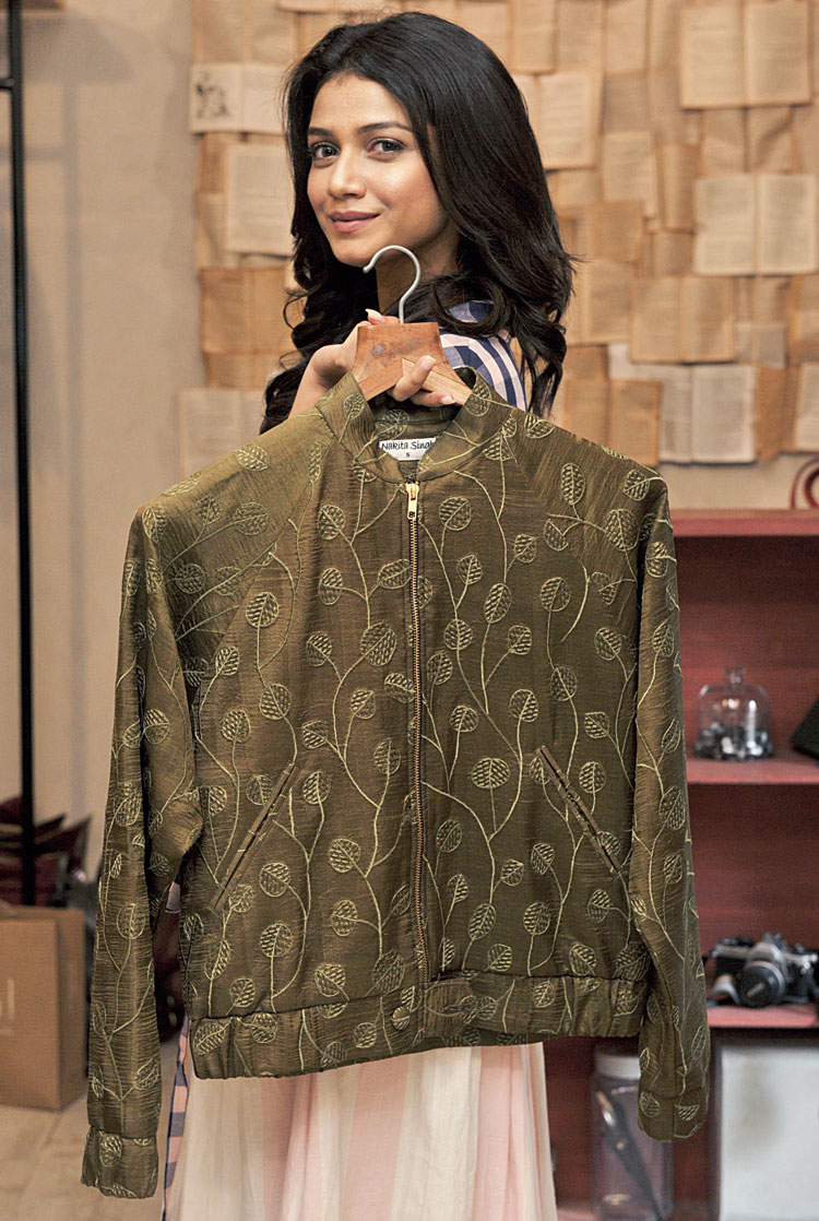 """She also picked an embroidered Nakita Singh bomber jacket in moss green as her other fave. """"This pop-up has such amazing clothes and the fact that it's for a good cause makes it even better,"""" she added."""