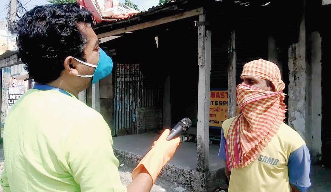 Avijit Roy asks a Falakata resident about the corona virus on Sunday.