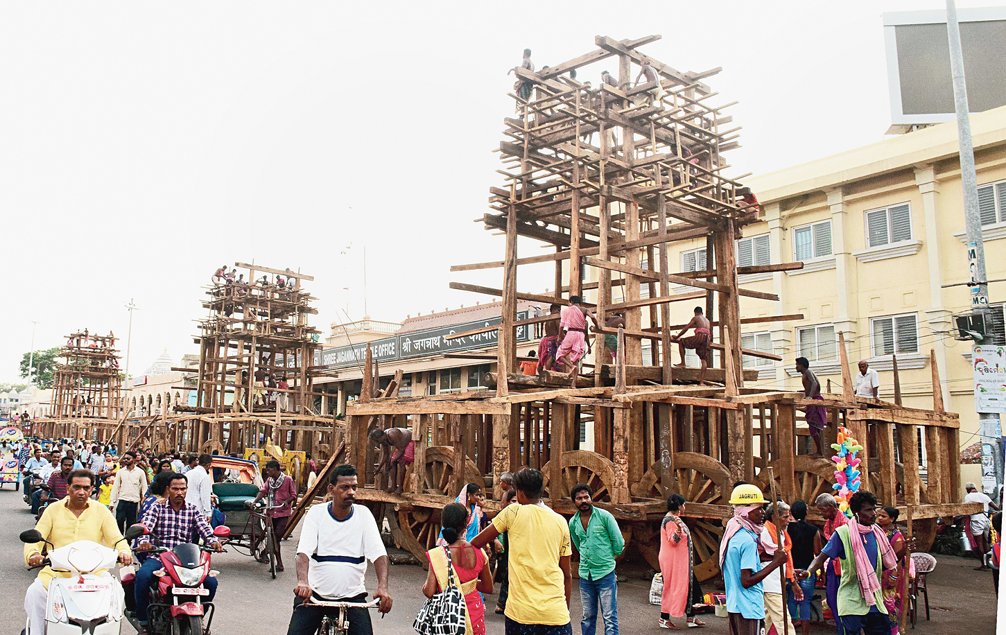 Artisans in Puri construct chariots for the Rath Yatra.