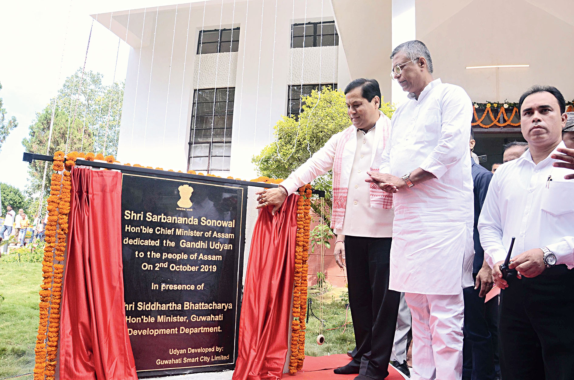 Assam chief minister Sarbananda Sonowal unveils the plaque during inauguration of the park in Guwahati