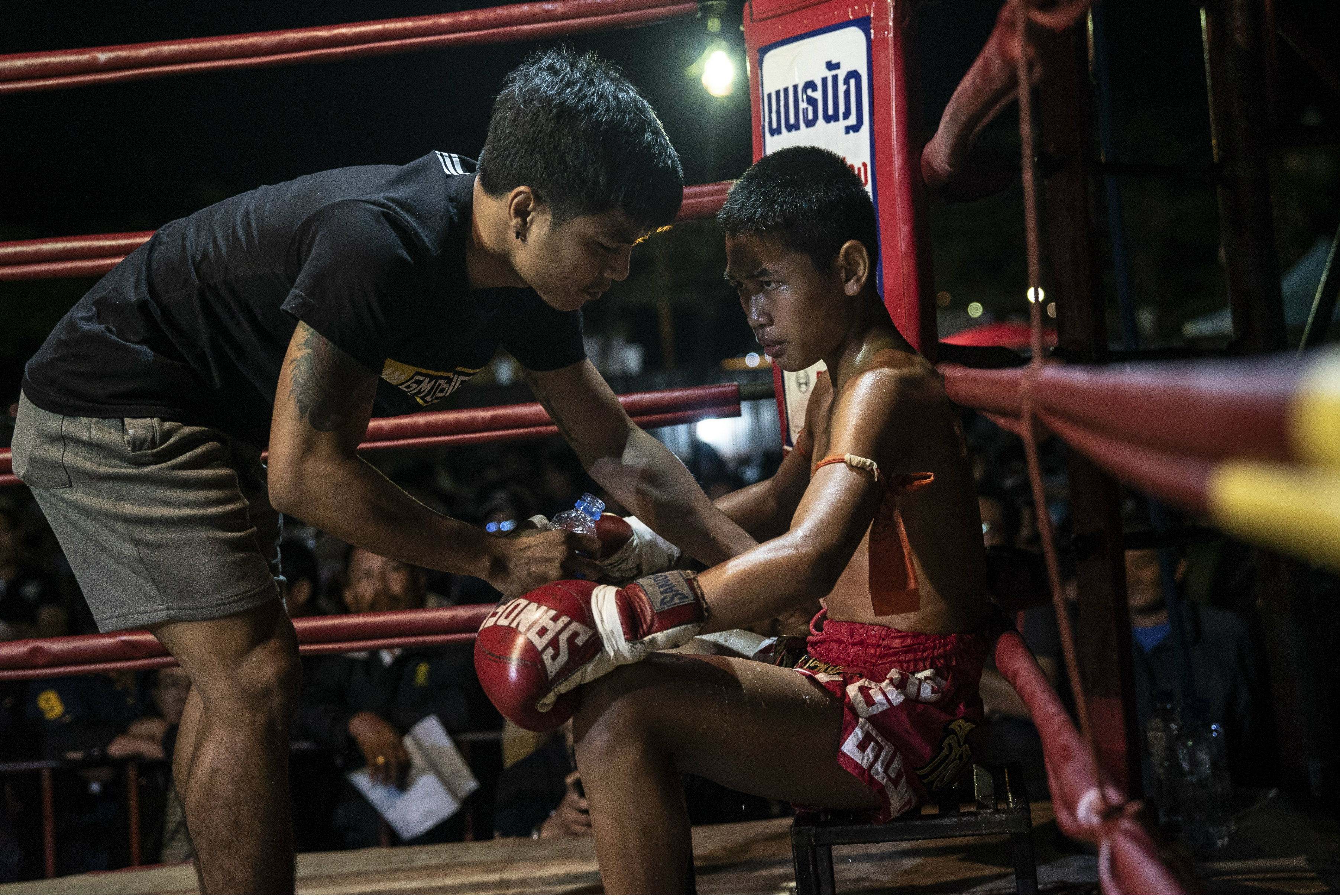 A young muay Thai fighter at a small local fighting stage in That Phanom, Thailand.