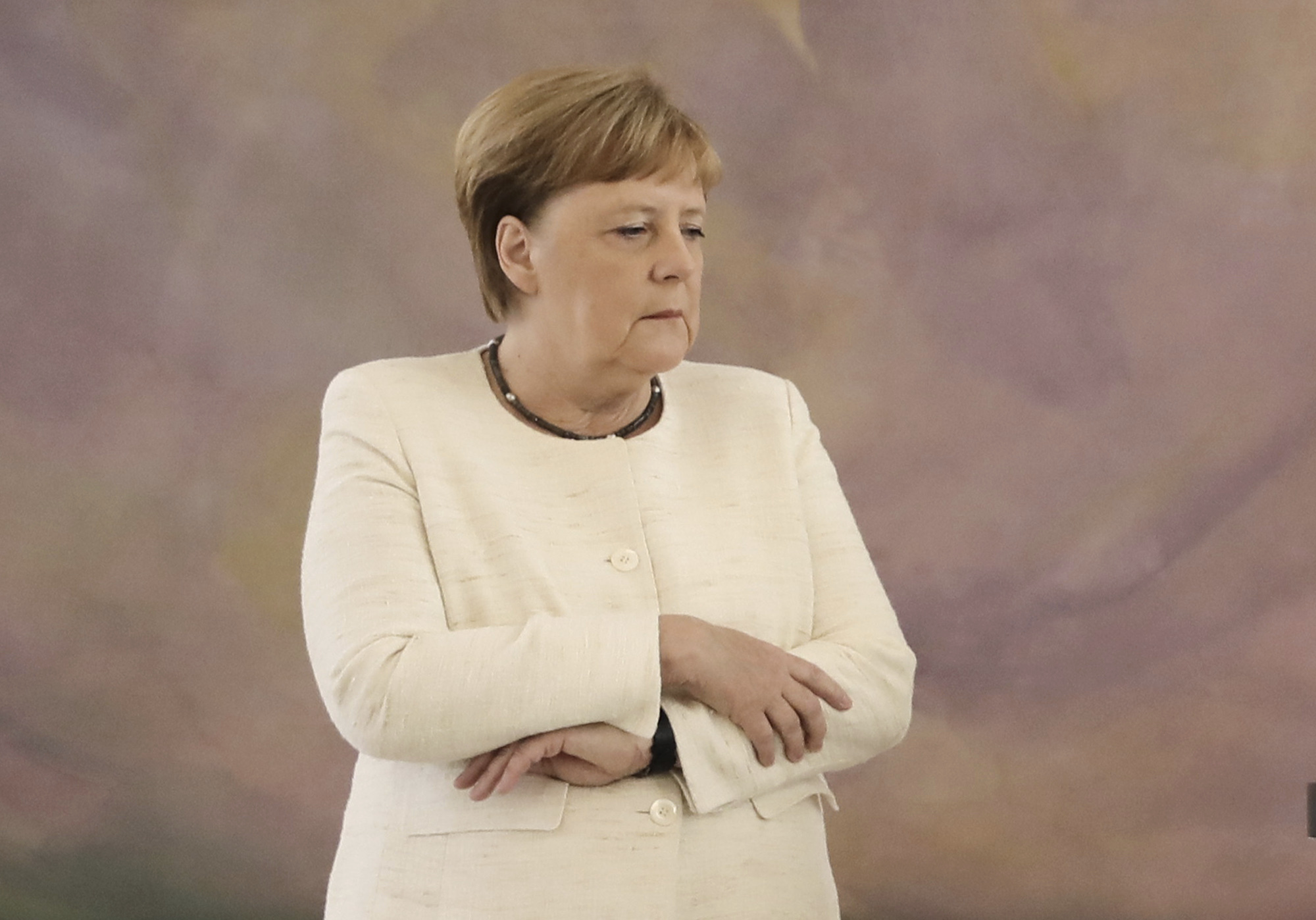Merkel, 64, folded her arms across her chest while her body trembled for around two minutes as she stood alongside President Frank-Walter Steinmeier at an indoor event.