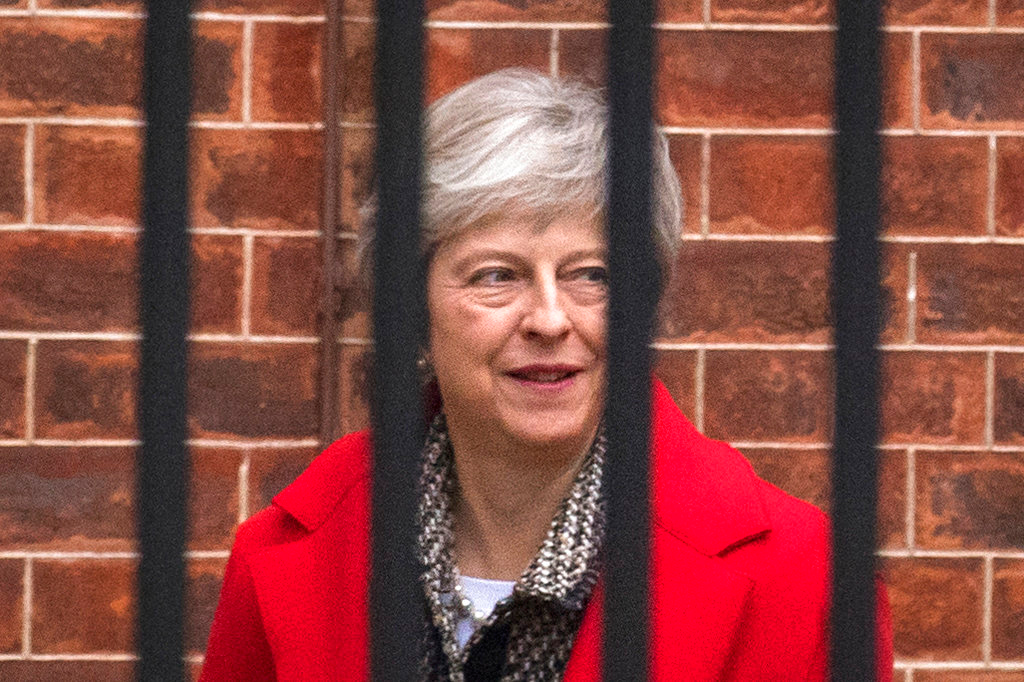Britain's Prime Minister Theresa May leaves Downing Street in London, Friday, Nov. 16, 2018.