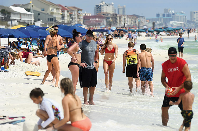 Beachgoers in Destin, Florida, during the Spring Break on March 18.